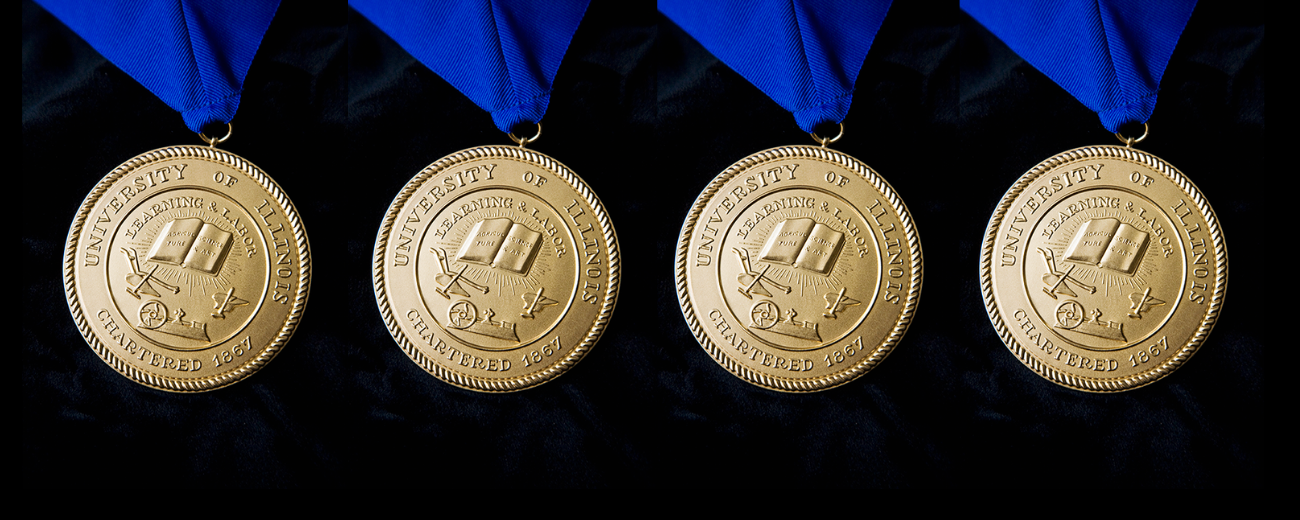 gold medallions of U of I seal on blue ribbons